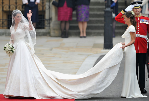 Royal Wedding Arrivals [royal wedding,gown,dress,wedding dress,white,clothing,bride,bridal clothing,red,bridal accessory,fashion,dress,catherine middleton,guests,way,crowds,marriage,westminster abbey,london,party]