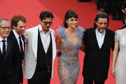 """(L-R) Actor Geoffrey Rush, producer Jerry Bruckheimer, actors Johnny Depp,Penelope Cruz,Ian McShane,Astrid Berges-Frisbey attend the """"Pirates of the Caribbean: On Stranger Tides"""" premiere at the Palais des Festivals during the 64th Cannes Film Festival on May 14, 2011 in Cannes, France."""