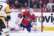 Goaltender Antti Niemi #37 of the Montreal Canadiens watches the puck as he protects his net against the Pittsburgh Penguins during the NHL game at the Bell Centre on October 13, 2018 in Montreal, Quebec, Canada.  The Montreal Canadiens defeated the Pittsburgh Penguins 4-3 in a shootout.