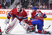 Goaltender Antti Niemi #37 of the Montreal Canadiens protects his net while teammate Mike Reilly #28 defends against the Pittsburgh Penguins during the NHL game at the Bell Centre on October 13, 2018 in Montreal, Quebec, Canada.  The Montreal Canadiens defeated the Pittsburgh Penguins 4-3 in a shootout.