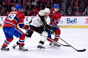 Evgeni Malkin #71 of the Pittsburgh Penguins attempts to move the puck past Nathan Beaulieu #28 and Andrei Markov #79 of the Montreal Canadiens during the NHL game at the Bell Centre on January 10, 2015 in Montreal, Quebec, Canada.  The Penguins defeated the Canadiens 2-1 in overtime.