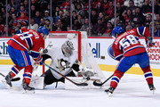 Marc-Andre Fleury #29 of the Pittsburgh Penguins stops the puck on an attempt by Sven Andrighetto #58 of the Montreal Canadiens during the NHL game at the Bell Centre on January 10, 2015 in Montreal, Quebec, Canada.