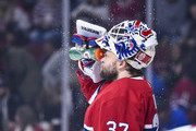 Goaltender Antti Niemi #37 of the Montreal Canadiens sprays water against the Pittsburgh Penguins during the NHL game at the Bell Centre on October 13, 2018 in Montreal, Quebec, Canada.  The Montreal Canadiens defeated the Pittsburgh Penguins 4-3 in a shootout.