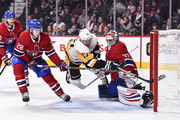 Bryan Rust #17 of the Pittsburgh Penguins tries to get a shot on goaltender Antti Niemi #37 of the Montreal Canadiens during the NHL game at the Bell Centre on October 13, 2018 in Montreal, Quebec, Canada.  The Montreal Canadiens defeated the Pittsburgh Penguins 4-3 in a shootout.