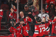 (l-r) Kyle Palmieri #21, Taylor Hall #9 and Nico Hischier #13 of the New Jersey Devils celebrate Palmieri's goal at 12:19 of the first period against the Pittsburgh Penguins at the Prudential Center on March 29, 2018 in Newark, New Jersey.