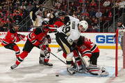 Cory Schneider #35 of the New Jersey Devils makes a save on a shot by David Perron #39 of the Pittsburgh Penguins during the first period at the Prudential Center on January 30, 2015 in Newark, New Jersey.
