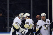 Matt Murray #30, Kris Letang #58 and Sidney Crosby #87 of the Pittsburgh Penguins celebrate their 5-0 shutout against the New York Rangers in Game Four of the Eastern Conference First Round during the 2016 NHL Stanley Cup Playoffs at Madison Square Garden on April 21, 2016 in New York City.