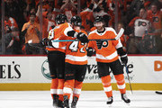 (l-r) Ivan Provorov #9, Andrew MacDonald #47 and Sean Couturier #14 of the Philadelphia Flyers celebrate a goal by MacDonald at 15:48 of the first period against the Pittsburgh Penguins  in Game Six of the Eastern Conference First Round during the 2018 NHL Stanley Cup Playoffs at the Wells Fargo Center on April 22, 2018 in Philadelphia, Pennsylvania.