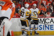 Jake Guentzel #59 of the Pittsburgh Penguins (r) celebrates his goal at 12:58 of the third period against the Philadelphia Flyers and is joined by Sidney Crosby #87 (l) in Game Six of the Eastern Conference First Round during the 2018 NHL Stanley Cup Playoffs at the Wells Fargo Center on April 22, 2018 in Philadelphia, Pennsylvania. The Penguins defeated the Flyers 8-5 to win the series 4-2.