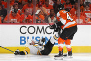 Sidney Crosby #87 of the Pittsburgh Penguins is tripped up by Andrew MacDonald #47 of the Philadelphia Flyers during the first period in Game Six of the Eastern Conference First Round during the 2018 NHL Stanley Cup Playoffs at the Wells Fargo Center on April 22, 2018 in Philadelphia, Pennsylvania.