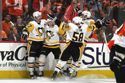 Jake Guentzel #59 of the Pittsburgh Penguins (2nd from left)celebrates his goal at 12:48 of the third period against the Philadelphia Flyers and is joined by Sidney Crosby #87 (l) and Kris Letang #58 (r) in Game Six of the Eastern Conference First Round during the 2018 NHL Stanley Cup Playoffs at the Wells Fargo Center on April 22, 2018 in Philadelphia, Pennsylvania. The Penguins defeated the Flyers 8-5 to win the series 4-2.