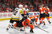 Andrew MacDonald #47 of the Philadelphia Flyers is checked by Patric Hornqvist #72 of the Pittsburgh Penguins during the third period in Game Three of the Eastern Conference First Round during the 2018 NHL Stanley Cup Playoffs at the Wells Fargo Center on April 15, 2018 in Philadelphia, Pennsylvania. The Penguins defeated the Flyers 5-1.