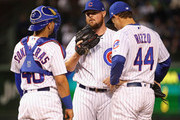 Willson Contreras #40 and Anthony Rizzo #44 of the Chicago Cubs.chat with starting pitcher Jon Lester #34 after Lester loaded the bases in the first inning against the Pittsburgh Pirates at Wrigley Field on September 27, 2018 in Chicago, Illinois.