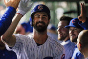 Cole Hamels #35 of the Chicago Cubsis congratulated in the dugout after hitting a home run against the Pittsburgh Pirates during the third inning at Wrigley Field on September 24, 2018 in Chicago, Illinois.