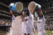 Freddy Galvis #13 of the Philadelphia Phillies gets sports drink poured on him by Tommy Joseph #19 and Andres Blanco #4 after the game against the Pittsburgh Pirates at Citizens Bank Park on July 3, 2017 in Philadelphia, Pennsylvania. The Phillies defeated the Pirates 4-0.