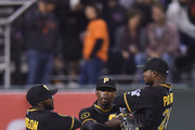 (L-R) Josh Harrison #5, Andrew McCutchen #22 and Gregory Polanco #25 of the Pittsburgh Pirates celebrate defeating the San Francisco Giants 5-0 at AT&T Park on July 28, 2014 in San Francisco, California.
