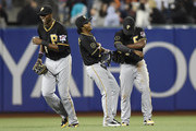 (L-R) Gregory Polanco #25, Michael Martinez #3 and Andrew McCutchen #22 of the Pittsburgh Pirates celebrate defeating the San Francisco Giants 3-1 at AT&T Park on July 29, 2014 in San Francisco, California.