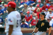 Justin Morneau #66 of the Pittsburgh Pirates hits a single against the Texas Rangers in the fifth inning at Rangers Ballpark in Arlington on September 11, 2013 in Arlington, Texas.