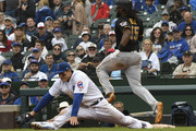 Josh Bell #55 of the Pittsburgh Pirates beats out an infield single as Anthony Rizzo #44 of the Chicago Cubs takes a throw during the eighth inning on June 10, 2018 at Wrigley Field in Chicago, Illinois. The Pirates won 7-1.