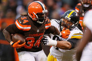 Isaiah Crowell #34 of the Cleveland Browns stiff arms Cameron Heyward #97 of the Pittsburgh Steelers during the third quarter at FirstEnergy Stadium on January 3, 2016 in Cleveland, Ohio.