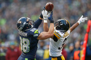 Tight end Jimmy Graham #88 of the Seattle Seahawks makes a catch against cornerback Ross Cockrell #31 of the Pittsburgh Steelers in the third quarter at CenturyLink Field on November 29, 2015 in Seattle, Washington.