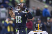 Tight end Jimmy Graham #88 of the Seattle Seahawks reacts after making a reception during the second half of a football game against the Pittsburgh Steelers at CenturyLink Field on November 29, 2015 in Seattle, Washington. At right is linebacker Lawrence Timmons #94 of the Pittsburgh Steelers.