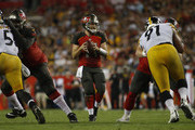 Quarterback Ryan Fitzpatrick #14 of the Tampa Bay Buccaneers looks for an open receiver during the third quarter of a game against the Pittsburgh Steelers on September 24, 2018 at Raymond James Stadium in Tampa, Florida.