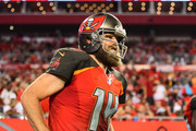 Ryan Fitzpatrick #14 of the Tampa Bay Buccaneers runs out of the locker room during the end of halftime in a game against the Pittsburgh Steelers on September 24, 2018 at Raymond James Stadium in Tampa, Florida.