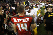 Quarterback Ryan Fitzpatrick #14 of the Tampa Bay Buccaneers and quarterback Ben Roethlisberger #7 of the Pittsburgh Steelers meet up on the field following the Steelers' 30-27 win over the Buccaneers on September 24, 2018 at Raymond James Stadium in Tampa, Florida.