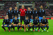 The England team (L-R back row) James Milner, Phil Jagielka, Joe Hart, Tom Cleverley, Ashley Cole and Joleon Lescott, (L-R front row) Wayne Rooney, Michael Carrick, Steven Gerrard, Jermain Defoe and Glen Johnson line up before the FIFA 2014 World Cup Qualifier between Poland and England at the National Stadium on October 17, 2012 in Warsaw, Poland.