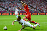 Yuriy Zhirkov of Russia clashes with Marcin Wasilewski of Poland during the UEFA EURO 2012 group A match between Poland and Russia at The National Stadium on June 12, 2012 in Warsaw, Poland.
