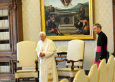 Pope Benedict XVI (L) flanked by his personal secretary Monsignor Georg Ganswein (R), waits at his private library for a meeting with the President of the Republic of Macedonia Nikola Gruevski on May 24, 2012 in Vatican City, Vatican.