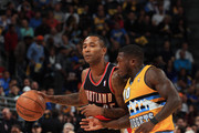 Mo Williams #25 of the Portland Trail Blazers controls the ball against Nate Robinson #10 of the Denver Nuggets at Pepsi Center on November 1, 2013 in Denver, Colorado. The Trail Blazers defeated the Nuggets 113-98. NOTE TO USER: User expressly acknowledges and agrees that, by downloading and or using this photograph, User is consenting to the terms and conditions of the Getty Images License Agreement.