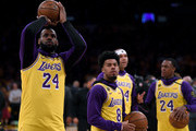 LeBron James and Quinn Cook wear number 24 and number 8 jerseys, to honor Kobe Bryant before the game against the Portland Trail Blazers at Staples Center on January 31, 2020 in Los Angeles, California.