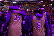 (L-R) Anthony Davis, LeBron James, Quinn Cook and Kentavious Caldwell-Pope of the Los Angeles Lakers react at the end of the National Anthem during a ceremony to honor Kobe Bryant before the game against the Portland Trail Blazers at Staples Center on January 31, 2020 in Los Angeles, California.