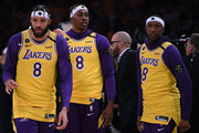 (L-R) JaVale McGee, Dwight Howard and Kentavious Caldwell-Pope of the Los Angeles Lakers wear number 8 jerseys to honor Kobe Bryant before the game against the Portland Trail Blazers at Staples Center on January 31, 2020 in Los Angeles, California.
