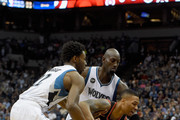 Andrew Wiggins #22 and Kevin Garnett #21 of the Minnesota Timberwolves defend against Damian Lillard #0 of the Portland Trail Blazers during the first quarter of the home opening game on November 2, 2015 at Target Center in Minneapolis, Minnesota. NOTE TO USER: User expressly acknowledges and agrees that, by downloading and or using this Photograph, user is consenting to the terms and conditions of the Getty Images License Agreement.
