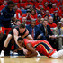 Pat Connaughton Photos - Pat Connaughton #5 of the Portland Trail Blazers has the ball stolen from him by Darius Miller #21 of the New Orleans Pelicans during Game 3 of the Western Conference playoffs against the Portland Trail Blazers at the Smoothie King Center on April 19, 2018 in New Orleans, Louisiana. NOTE TO USER: User expressly acknowledges and agrees that, by downloading and or using this photograph, User is consenting to the terms and conditions of the Getty Images License Agreement. - Portland Trail Blazers vs. New Orleans Pelicans - Game Three