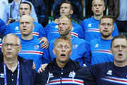 Eidur Gudjohnsen (C) and Iceland players sing the national anthem priro to the UEFA EURO 2016 Group F match between Portugal and Iceland at Stade Geoffroy-Guichard on June 14, 2016 in Saint-Etienne, France.
