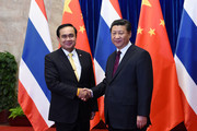 Thai Prime Minister Prayut Chan-o-cha (L) shakes hands with Chinese President Xi Jinping (R) during a signing ceremony at the Great Hall of the People on December 22, 2014 in Beijing, China. Prayut Chan-o-cha is on a visit to China from December 22 to 23.