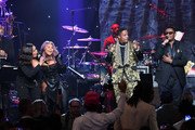 "(L-R) Faith Evans, Lil' Kim, Ma$e, and Carl Thomas perform onstage during the Pre-GRAMMY Gala and GRAMMY Salute to Industry Icons Honoring Sean ""Diddy"" Combs on January 25, 2020 in Beverly Hills, California."