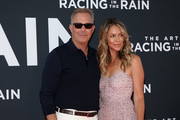 """Kevin Costner and Christine Baumgartner attends the Premiere Of 20th Century Fox's """"The Art Of Racing In The Rain"""" at El Capitan Theatre on August 01, 2019 in Los Angeles, California."""