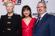"Tilda Swinton, Dakota Johnson and Ted Hope attend the premiere of Amazon Studios' ""Suspiria"" at ArcLight Cinerama Dome on October 24, 2018 in Hollywood, California."