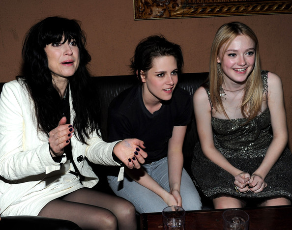 Director Floria Sigismondi, actress Kristen Stewart and actress Dakota Fanning attend the after party for the premiere of Apparition's 'The Runaways' held at ArcLight Cinemas Cinerama Dome on March 11, 2010 in Los Angeles, California.