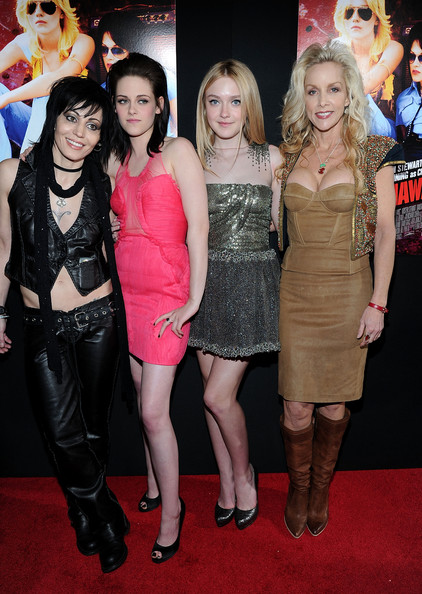 "Musician Joan Jett, actresses Kristen Stewart, Dakota Fanning, and musician Cherie Currie arrive at the premiere of Apparition's ""The Runaways"" held at ArcLight Cinemas Cinerama Dome on March 11, 2010 in Los Angeles, California."