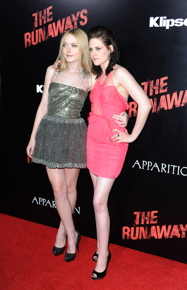 Actors Dakota Fanning and Kristen Stewart, arrive at the premiere of Apparition's 'The Runaways' held at ArcLight Cinemas Cinerama Dome on March 11, 2010 in Los Angeles, California.
