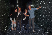 """CEO of Artist Partner Group (APG) Mike Caren (right) and guests in the LED infinity tunnel at the Premiere Of Charlie Puth's New Single """"Attention"""" - In Partnership With Spotify, Artist Partner Group (APG) And Atlantic Records at THE ATTENTION ROOM on April 19, 2017 in Los Angeles, California."""