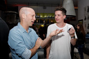 Mike Caren and Charlie Puth drink Lavazza Coffee at the Premiere Of Charlie Puth's new single 'Attention', in partnership with Spotify, Artist Partner Group (APG) and Atlantic Records at THE ATTENTION ROOM on April 19, 2017 in Los Angeles, California.