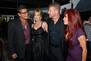 Actors Steven Bauer, Melanie Griffith, Michael Cuditz, and producer Suzanne DeLaurentiis arrive at the Premiere Of 'Dark Tourist' at ArcLight Hollywood on August 14, 2013 in Hollywood, California.