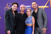 """(L-R) Trey Smith, Jaden Smith, Jada Pinkett Smith, and Will Smith attend the premiere of Disney's """"Aladdin"""" on May 21, 2019 in Los Angeles, California."""
